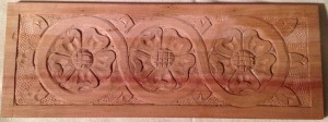 Completed carved panel with three heraldic roses